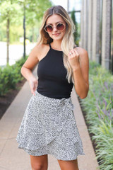 White - Model wearing the Spotted Wrap Skirt with a black bodysuit