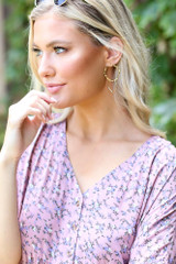 Model wearing the Gold Hammered Drop Earrings