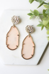 Pink - Flat Lay of the Gold Statement Earrings on a white background