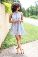 Model wearing the Floral Halter Swing Dress with nude heels