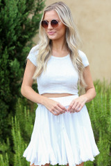 Model wearing the Ribbed Knit Crop Top with a white skirt