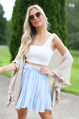 Model wearing the Swing Skort in Light Blue with a white crop top