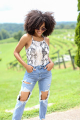 Model wearing the Square Neck Snakeskin Bodysuit with distressed boyfriend jeans