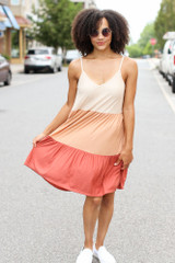 Model wearing the Tiered Color Block Dress with white sneakers