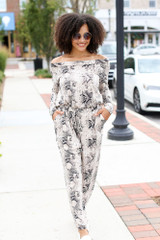 Model wearing a Snakeskin Jumpsuit with white sneakers