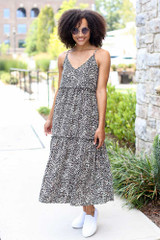 Model wearing the Tiered Leopard Midi Dress with white slip on sneakers
