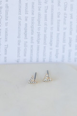 Flat Lay of one of the earrings in the V-Stud Gold Earring Set