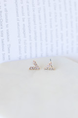 Flat Lay of the V-Stud Gold Earring Set