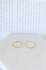 Flat Lay of 2 of the rings in the Heart Ring Set