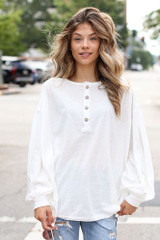 Ivory - Model wearing an Oversized Henley Top with denim jeans