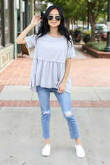 Dress Up model wearing a Swiss Dot Babydoll Top with distressed skinny jeans