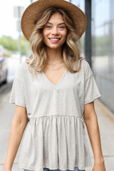 Grey - Model wearing a Knit Babydoll Top with a straw sun hat