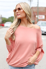 Peach - Model wearing a Soft Knit Dolman Sleeve Top with distressed denim shorts