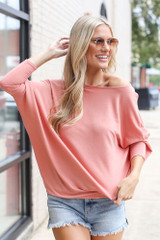 Peach - Dress Up model wearing a Soft Knit Dolman Sleeve Top with distressed denim shorts