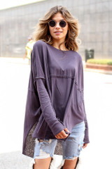 Model wearing an Oversized Top in Grey with distressed boyfriend jeans