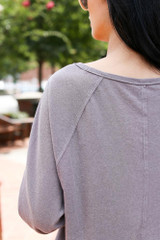 Close Up of the back of an Oversized Top in Grey