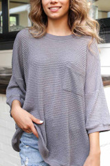 Close Up of an Oversized Waffle Knit Top in Charcoal