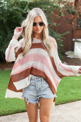Model wearing a Striped Knit Sweater with denim shorts
