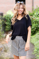 Model wearing a Striped Button Front Denim Skirt with a black tee