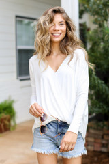 White - Model wearing a Surplice Top with denim shorts