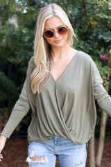 Olive - Dress Up model wearing a Surplice Top with skinny jeans