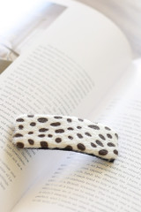Ivory - Flat Lay of a Spotted Hair Clip