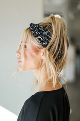 Model wearing a Leopard Print Knotted Headband