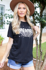 Dress Up model wearing an Oversized Graphic Tee with a wide brim hat and denim shorts