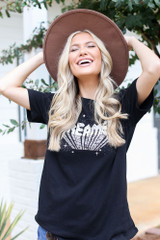 Model wearing an Oversized Graphic Tee
