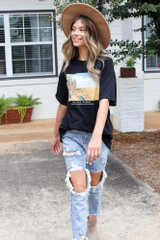 Model wearing a Desert Oversized Graphic Tee with distressed boyfriend jeans
