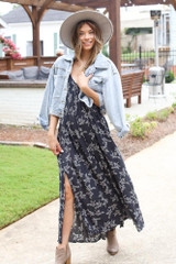 Dress Up model wearing a Floral Maxi Dress with a cropped denim jacket