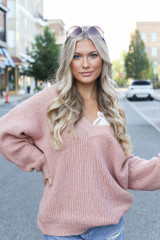 Blush - Model wearing an Oversized Sweater with a lace bralette