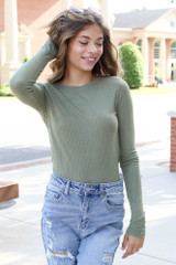 Olive - Dress Up model wearing a Ribbed Knit Top with distressed skinny jeans