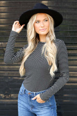 Black/White - Model wearing a Ribbed Knit Top with a wide brim hat