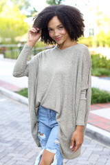 Sage - Model wearing an Oversized Brushed Knit Top with distressed boyfriend jeans