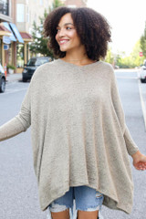 Sage - Dress Up model wearing an Oversized Brushed Knit Top with distressed boyfriend jeans