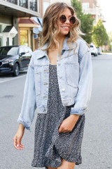 Model wearing a black Tiered Floral Dress with a cropped denim jacket