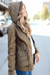 Model wearing a green Utility Jacket