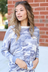 Dress Up model wearing an Oversized Camo Top with the matching joggers