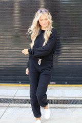 Dress Up model wearing black Brushed Knit Joggers with the matching pullover