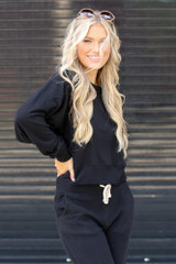 Dress Up model wearing a black Brushed Knit Pullover with the matching joggers