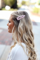 Blush - Model wearing a Flower Hair Clip