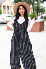 Dress Up model wearing a Striped Jumpsuit with a wide brim hat