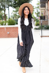 Model wearing a Striped Jumpsuit with a white tee underneath