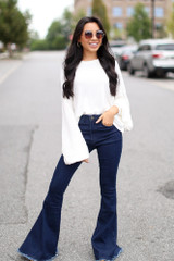 Model wearing High-Rise Flare Jeans