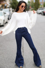 Model wearing High-Rise Flare Jeans with an oversized top