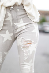 Close Up of Distressed Star Flare Jeans
