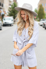 Dress Up model wearing a Tie-Front Romper with a wide brim hat
