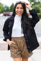 Model wearing Leopard Paperbag Waist Shorts with a denim jacket
