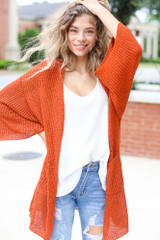 Rust - Model wearing a Lightweight Knit Cardigan